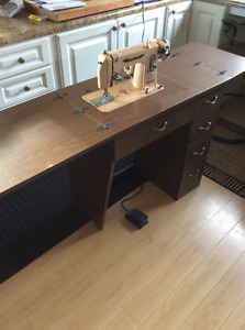 Sewing maching with cabinet