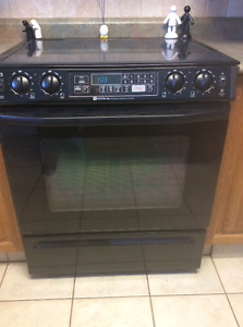 Black maytag stove-Samsung fridge with microwave