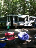 2002 12 ft jayco with 3 way pop out