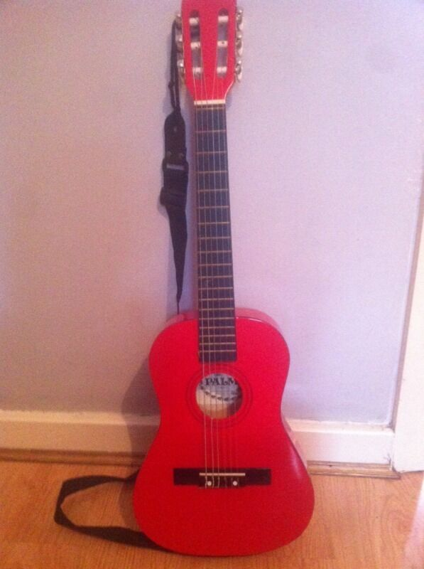 Small red guitar