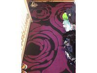 Large black and purple flower rug