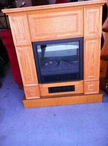 Oak mantle with fireplace heater works great
