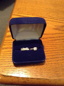 Engagement ring and matching diamond wedding band for sale.