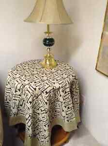 Two square matching table clothes $20