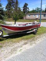 Motor 15 hp Johnson, 14 ft boat and trailer