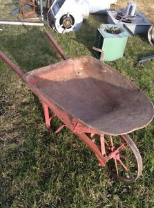 Old wheelbarrow awesome for flower bed projects