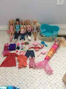 7 Barbies with pool and accessories for sale! Kitchener / Waterloo Kitchener Area image 1