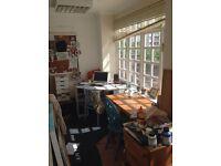 Desk space in a bright art studio, great views