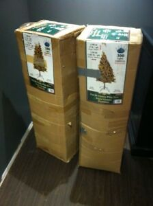 Two 6.5 ft Pre-Lit Christmas Trees $20 each