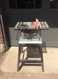 10 inch Delta table saw with stand.