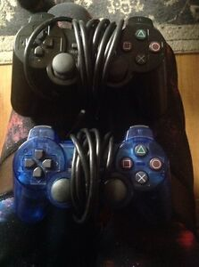2 sony play station controllers