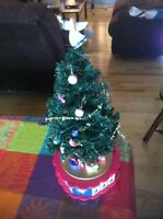 Christmas tree decoration. Plays music.