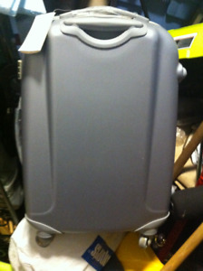 Polycarbon suitcase unused