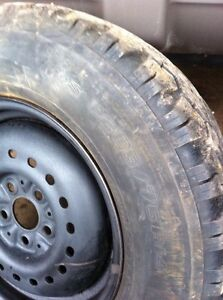 Two P205/75R14 studded snow tires+rims $50.