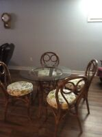 Glass/rattan table with 4 chairs