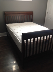 Double bed with mattress and boxspring.