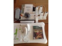 Nintendo Wii Consol with numchucks, remotes, games etc...