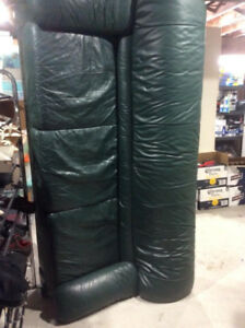 FREE ....TWO used dark green leather couches.  Both go together.