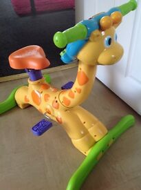 Childs musical giraff in good working condition.