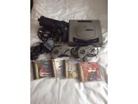 Japanese sega saturn console with games.