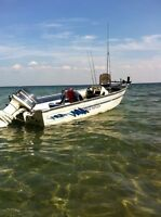 16.5 ft Sea Nymph side console with 70 evinrude