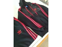 Adidas track suit, hardly worn so in very good condition.