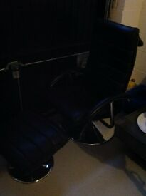 Black Leather and chrome recliner with footstool