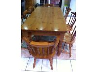 Solid pine table with 8 chairs