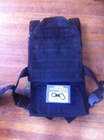 Bulletproof vest carrier and cuffs