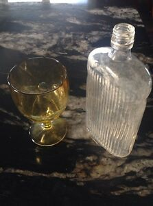 A decorative bottle and goblet.
