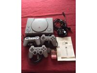 PlayStation 1 with 3 remotes