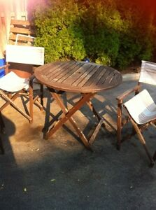 Teak table and 4 teaks chairs