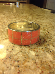 Silver and coral bangle