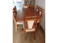Polished pine dining table & 6 chairs