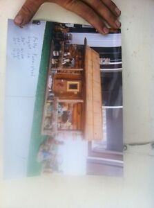 Hand made antique log home with figurines