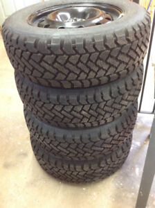 Set of 4 NEW Snow Tires Mounted on NEW Chev GM Rims