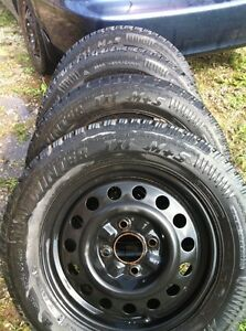 Like new 195/65R15 arctic claw snow tires