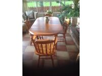 Solid pine country farmhouse style pine table and four pine chairs