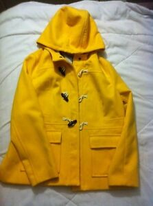 New yellow coat with hood, still with tag