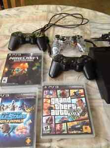 PlayStation 3 console with games and accessories