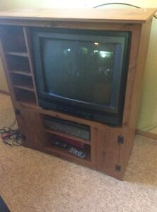 Box television and stand.