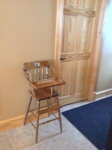 Wooden high chair in excellent condition