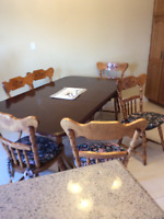 6 wooden chairs and a table