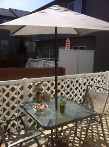 Deck table, umbrella, base and chairs