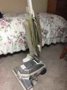 Kirby vacuum cleaner with carpet cleaning