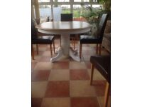 Beautiful Laura Ashley style oak circular extending table and four leather chairs.