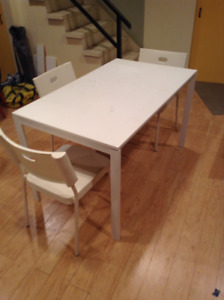 A dinning table and 3 chairs for sale