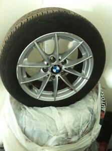 4--16 Inch by7 Original BMW Rims and Tires