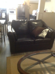 Free dark brown pleather couch and loveseat