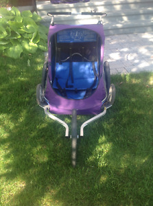 Double chariot stroller with attachments